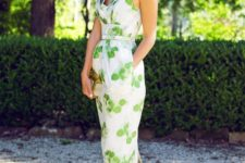 11 fitting midi V-neckline dress with a leaf print and metallic green shoes