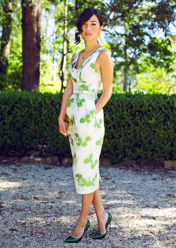 fitting midi V-neckline dress with a leaf print and metallic green shoes