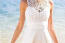 11 sleeveless mini dress with a crochet lace top