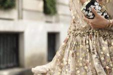 11 sparkling short gold dress with a deep V-neckline and a floral clutch