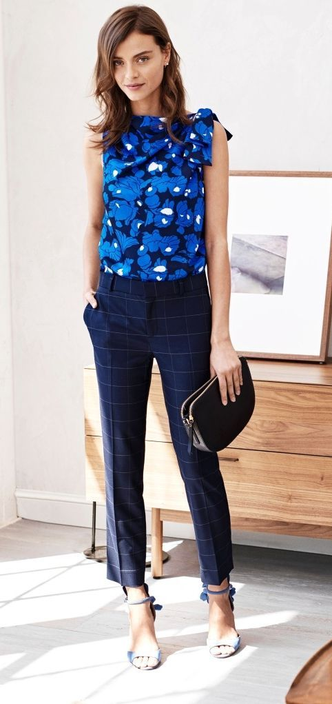 a bold sleeveless blue top, navy windowpane ankle pants and heeled sandals