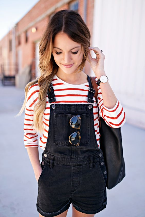 a red and white half sleeve shirt and a black denim overall