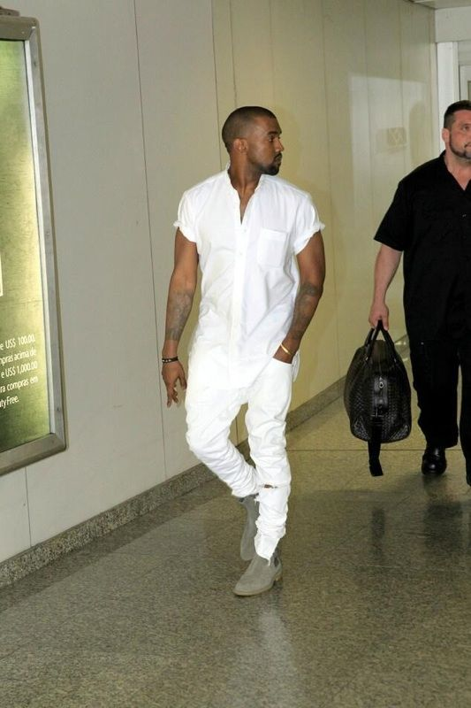 a white shirt with short sleeves, white distressed jeans and grey suede boots