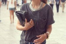 12 an oversized grey tee, denim shorts and lots of accessories create a chic look