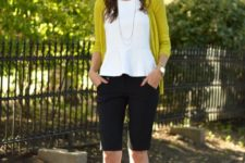 12 black bermuda shorts, a white ruche top, a mustard cardigan and black shoes