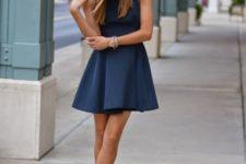 12 navy halter neckline flare mini dress with black ankle strap heels