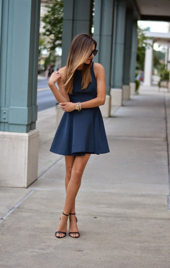 navy halter neckline flare mini dress with black ankle strap heels