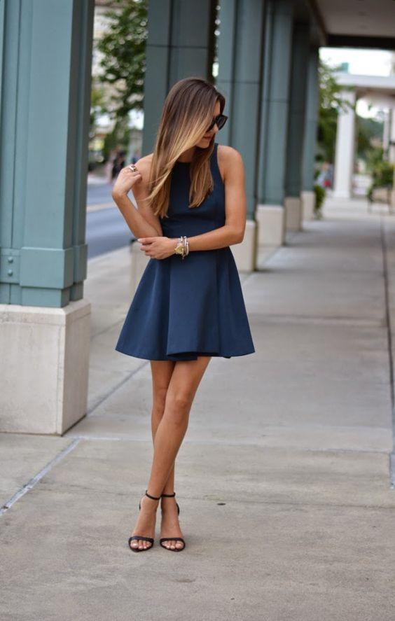 navy halter neckline flare mini dress with black ankle strap heels