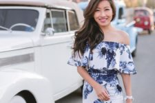 12 off the shoulder blue and white floral bodycon dress  and a white bag