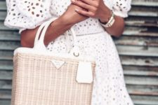 12 white off the shoulder perfeorated dress with half sleeves and a wicker Prada bag