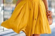 13 O-neck sleeveless loose yellow dress with brown shoes and a crossbody bag