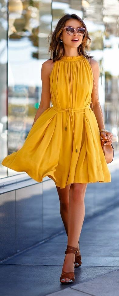 O-neck sleeveless loose yellow dress with brown shoes and a crossbody bag