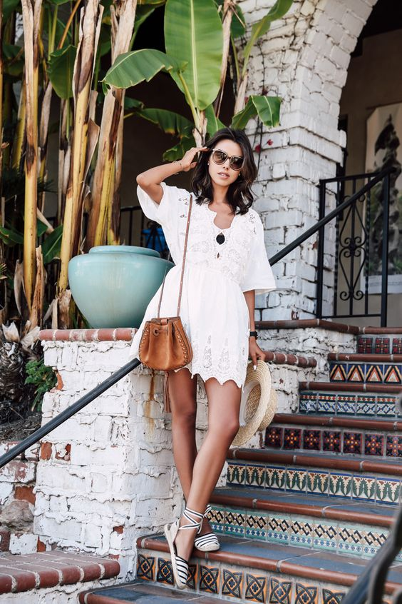 a little lace white dress with half sleeves and a cutout edge