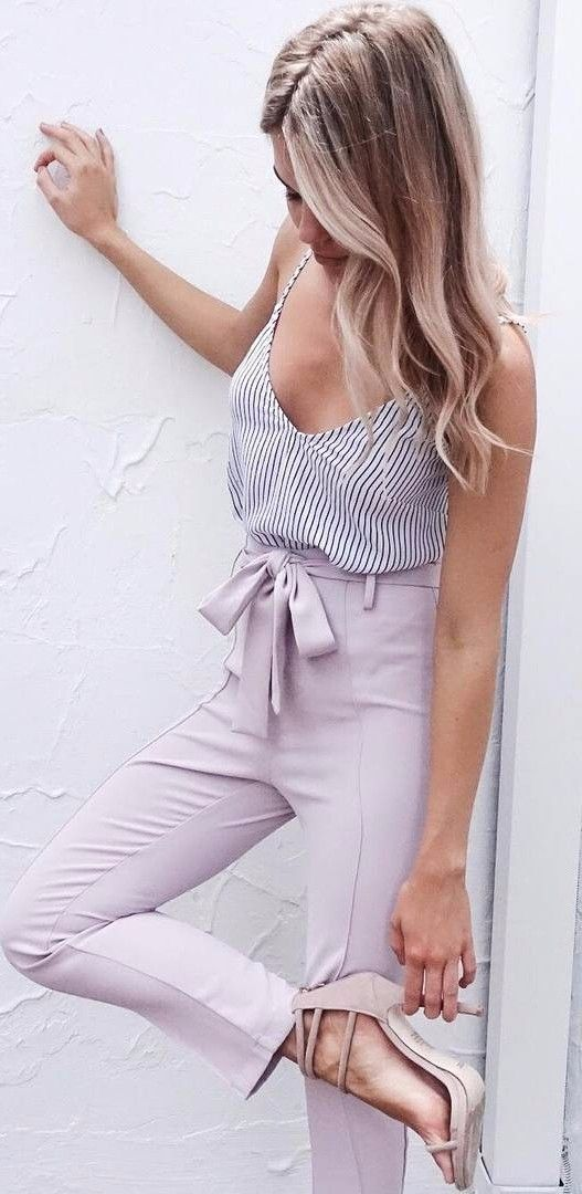 a striped tank top and lilac pants plus blush heels