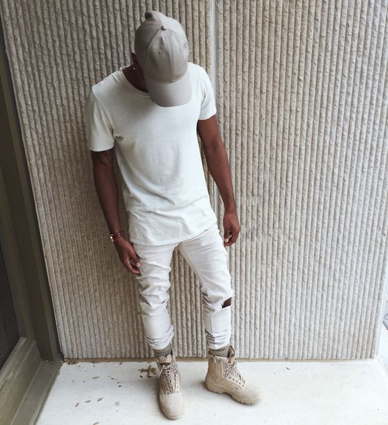 a white tee, white distressed jeans and neutral boots