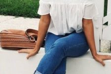13 ankle cuffed jeans, a white ruffle off the shoulder top and white sneakers
