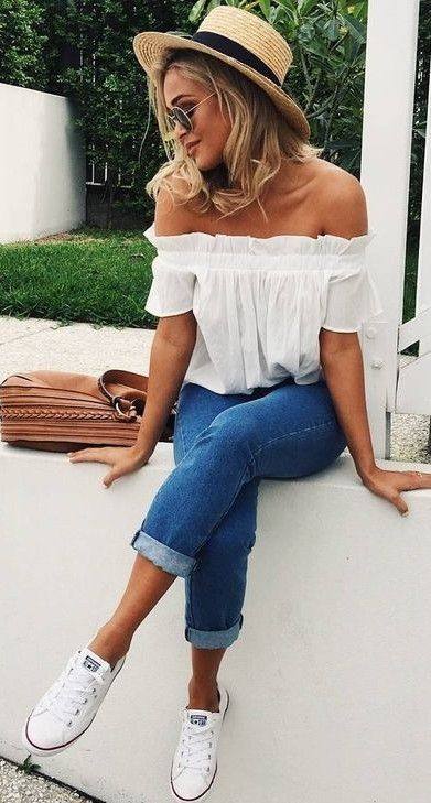 ankle cuffed jeans, a white ruffle off the shoulder top and white sneakers