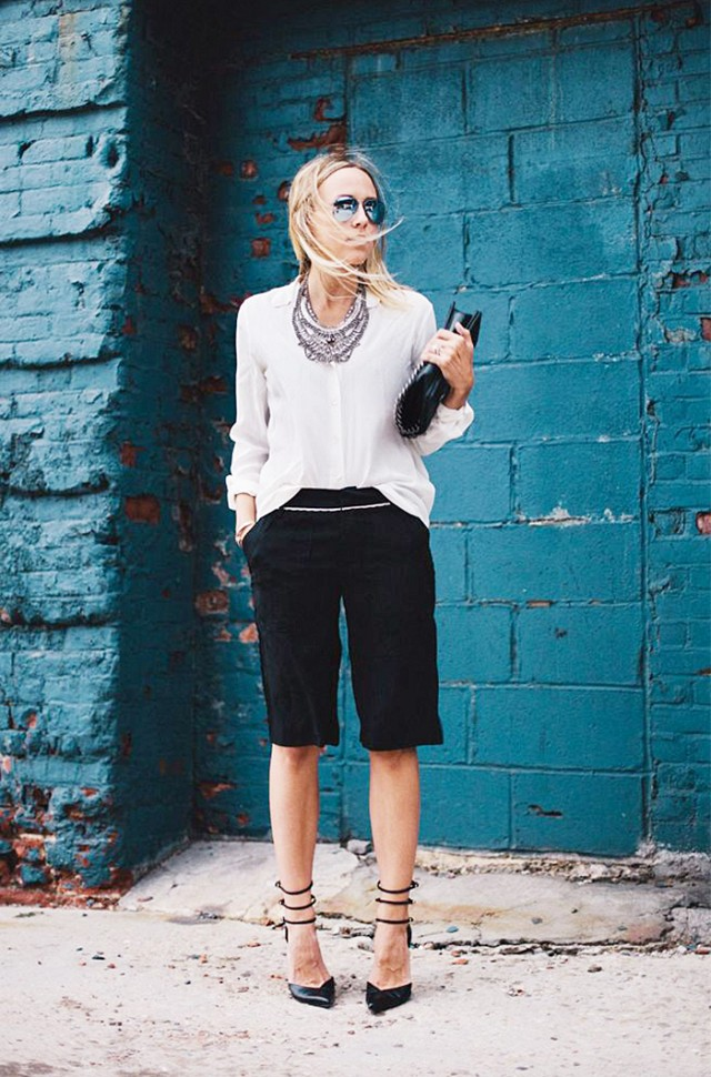 black knee shorts, a white shirt, black ankle strap shoes and a statement necklace