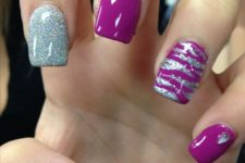 13 purple and silver glitter nails and accent nails with an abstract pattern