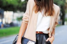 14 black leather shorts, a white top, a beige blazer and a studded clutch