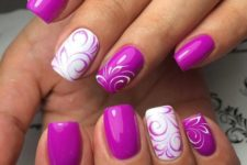 14 purple and white swirl manicure with floral patterns