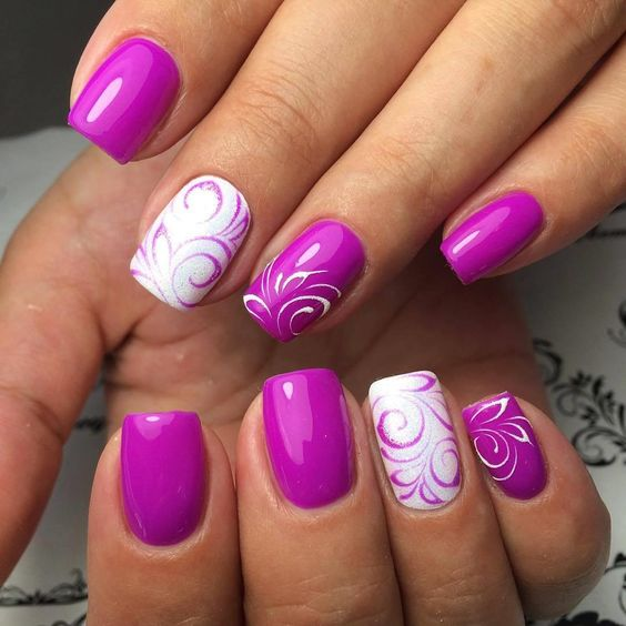 purple and white swirl manicure with floral patterns