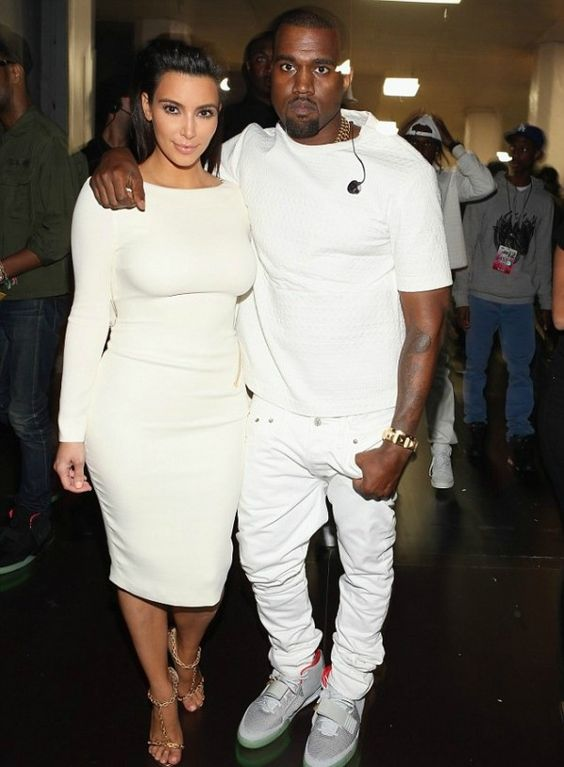 white jeans, a white tee and grey chucks by Kanye West