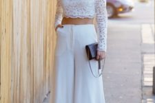 15 a lace long sleeve crop top and culotte pans, spike shoes and a black clutch