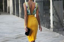 15 a yellow pencil knee skirt and a colorful printed top with a V back, heels and a clutch