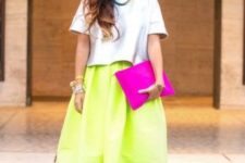 15 an oversized light blue tee, a neon green midi skirt, T ankle strap shoes