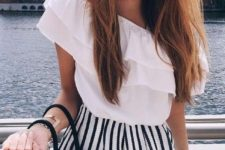 15 black and white striped shorts, a ruffled one shoulder top in white