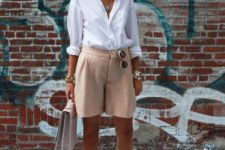 15 blush shorts, a white shirt, neutral retro-inspired shoes and a blush bag