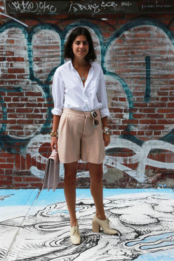 blush shorts, a white shirt, neutral retro-inspired shoes and a blush bag
