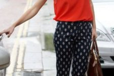 15 printed navy pants, a bold red strap top and brown shoes