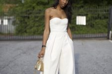 16 a strapless culotte jumpsuit, black ankle strap shoes and a metallic gold bag