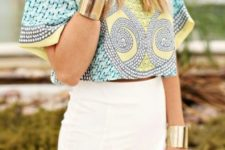 16 an ethnic print crop top with large sleeves and a tulip white skirt