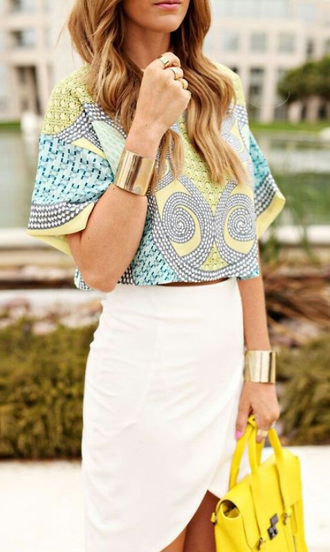 an ethnic print crop top with large sleeves and a tulip white skirt