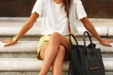 16 an oversized white tee, a yellow mini skirt, black flats and a bag