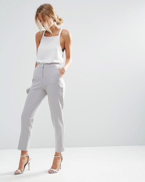 dove grey pants, a strap halter neckline top and white heeled sandals