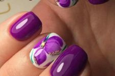 16 purple manicture with accent floral nails with beads and rhinestones