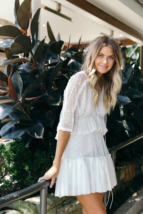 white boho dress with tiers and half sleeves, a V-neckline