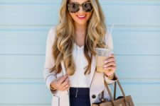 17 navy lace trim shorts, a white V-neckline top, a grey and navy blazer and a brown leather bag