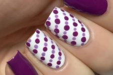 17 purple manicure with accent nails covered with lavender and purple polka dots