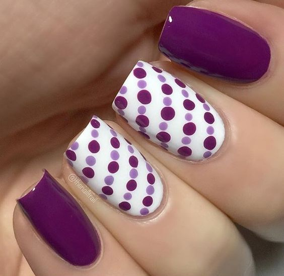 purple manicure with accent nails covered with lavender and purple polka dots