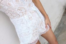 18 a white lace romper with a V-neckline and suede shoes