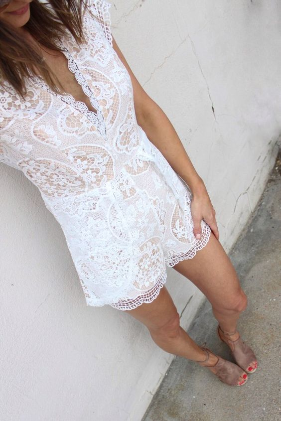 a white lace romper with a V neckline and suede shoes