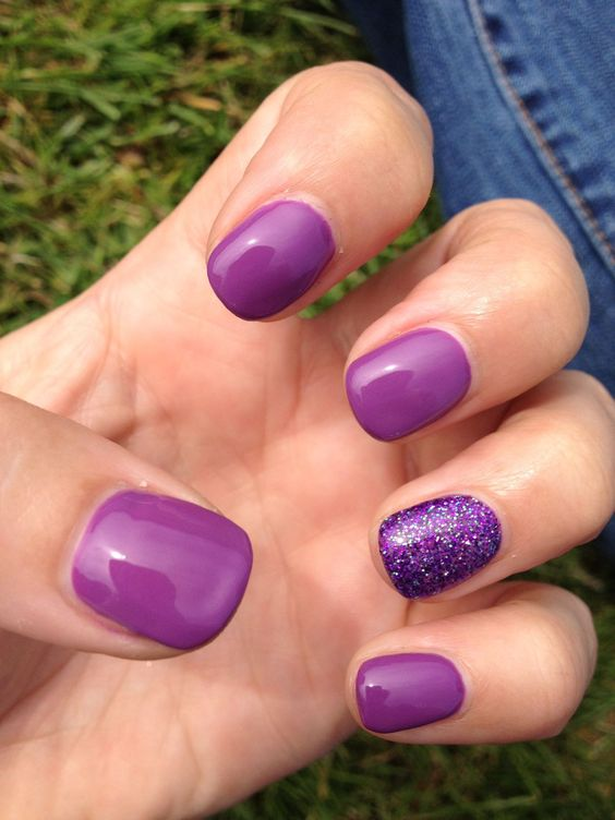 purple nails with an accent glitter ones