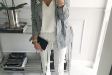 18 white trousers, a white V-neck top, ankle strap heeled sandals and a grey jacket