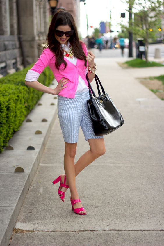 striped bermuda shorts, a white shirt, a pink cardigan and shoes