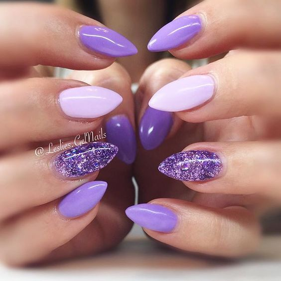 purple, purple glitter and blush nails look rather bold and cheery